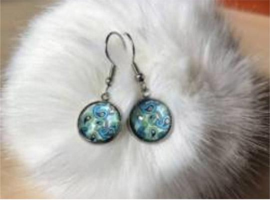 a pair of blue glass earrings