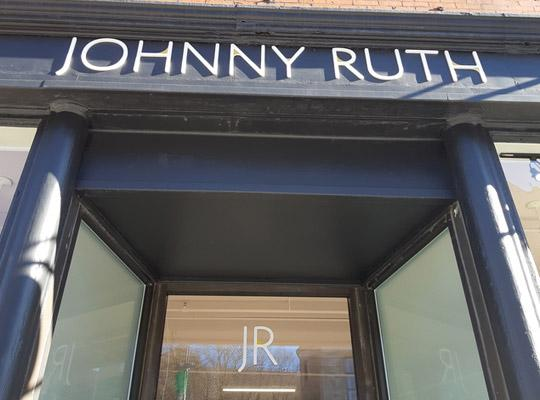 Johnny Ruth storefront signage