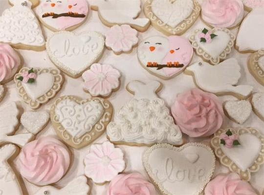 hand decorated sugar cookies in white, pink, hearts and love