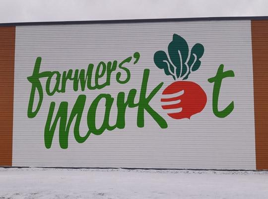 big st. john's farmers market logo on side of the building