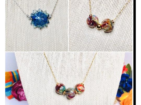 three Rocky Isle necklaces featuring glassworks beads
