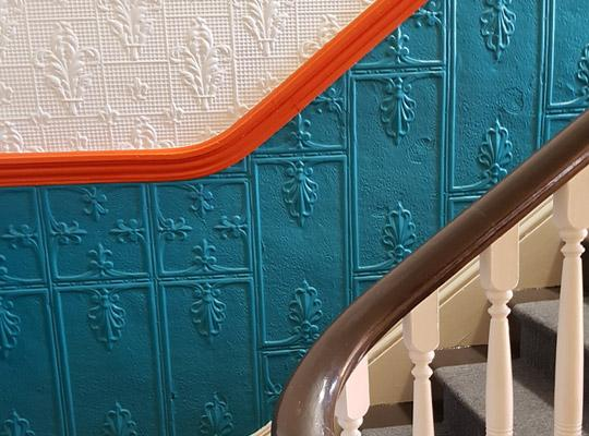 beautiful colours lead you up the stairs at Posie Row & Co
