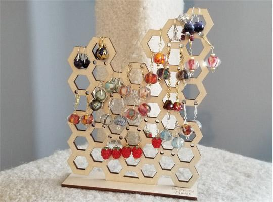 earrings on a honeycomb-shaped holder
